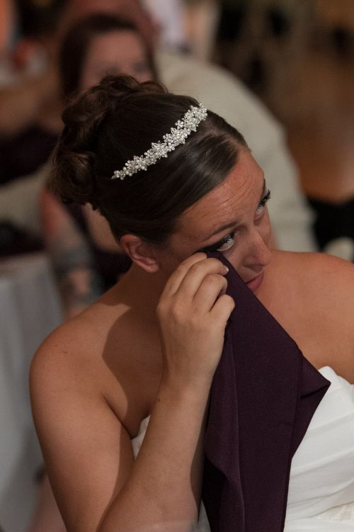 An emotional moment during the toasts. Thanks to Dartise Photography.