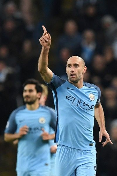 Manchester City's Argentinian defender Pablo Zabaleta celebrates scoring the opening goal during the English Premier League football match between Manchester City and Watford at the Etihad Stadium in Manchester, north west England, on December 14, 2016. / AFP / Paul ELLIS / RESTRICTED TO EDITORIAL USE. No use with unauthorized audio, video, data, fixture lists, club/league logos or 'live' services. Online in-match use limited to 75 images, no video emulation. No use in betting, games or…