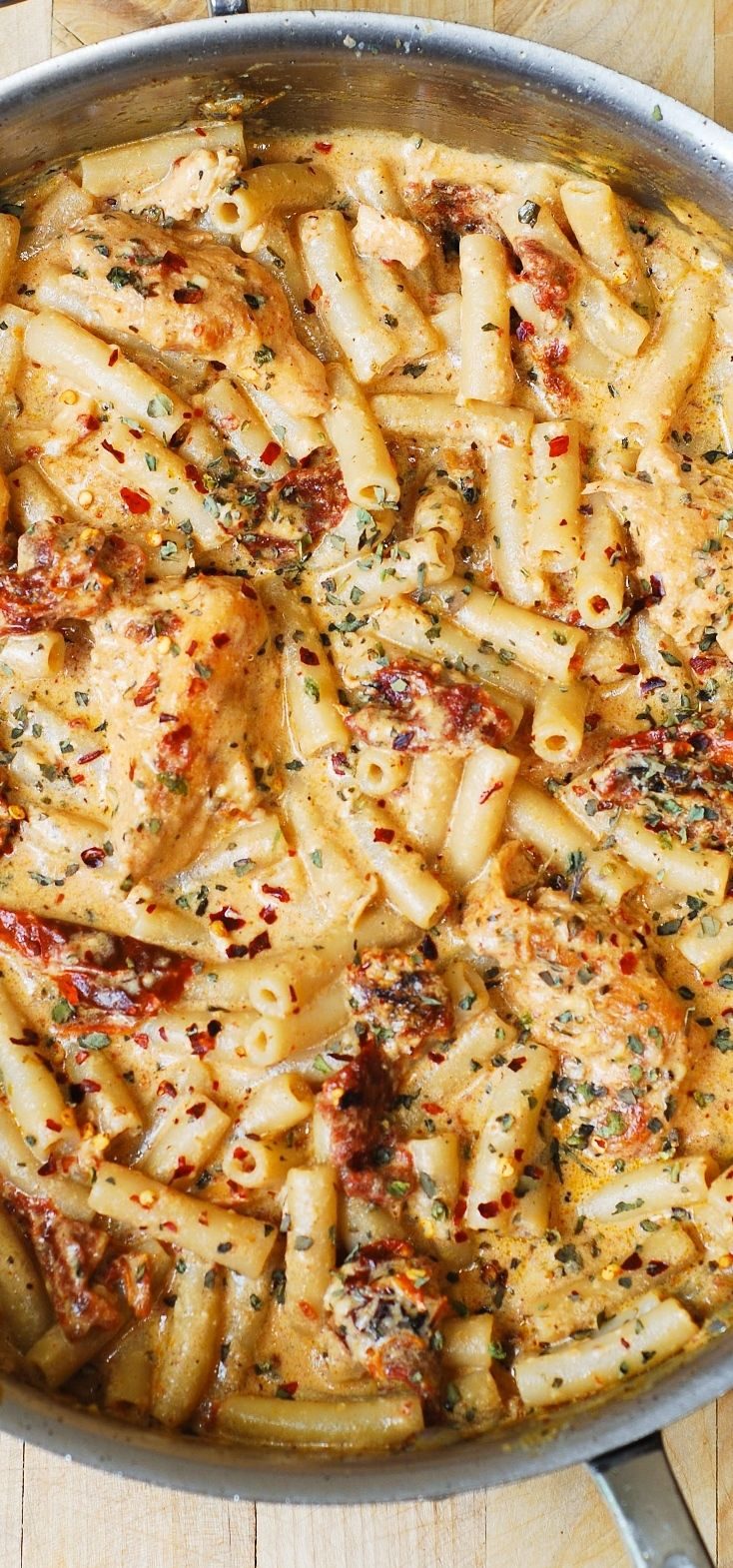 Chicken with sun-dried tomatoes and penne pasta in a creamy mozzarella cheese sauce seasoned with basil, crushed red pepper flakes. #recipe #chicken #pasta