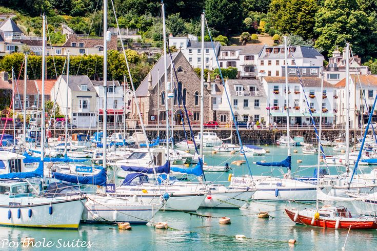 Picturesque and sheltered St Aubins harbour, looking towards the village and Porthole Suites.