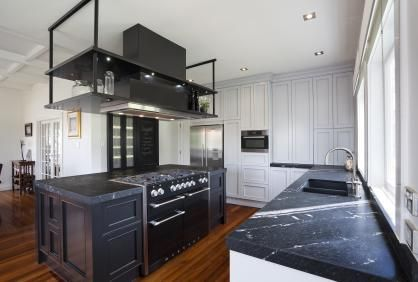It is an often told story – a grand residence let down by a rather average kitchen. Renovating this key space brings the double opportunity to introduce contemporary cooking convenience and bring the home's interiors into balance. A renovated kitchen featuring a Hideaway Bin - Click the image for the full article.