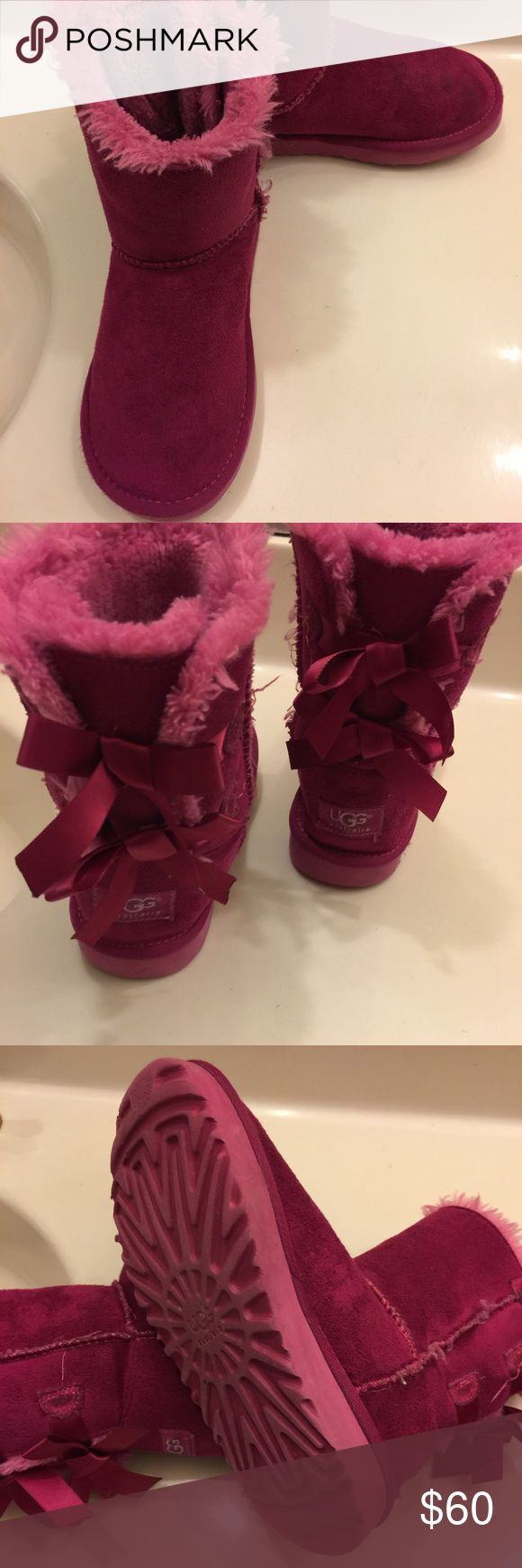 UGG Kids Bailey Bow UGG Kids Bailey Bow in excellent preowned condition. Please take a look at picture before making a purchase.  Size:1 UGG Australia Shoes Boots