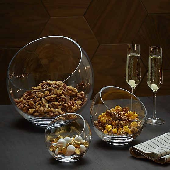 Handmade glass spheres are cut at an angle and polished for a modern look and easy access to snacks, candy, candles or floating blossoms.