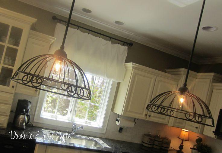 Wrought iron garden baskets are repurposed to make beautiful, interesting pendant kitchen lights.