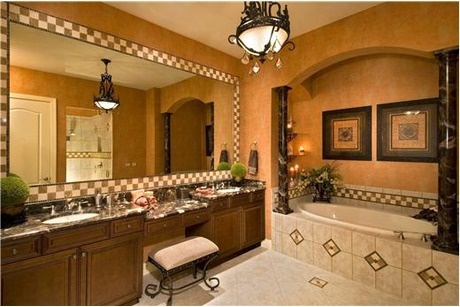 Checkerboard tile around mirror and tub unites this Tuscan-inspired Master Bath.Master Bath