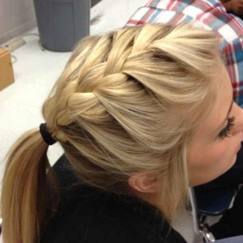 french braid into a pony tail. PERFECT for class!