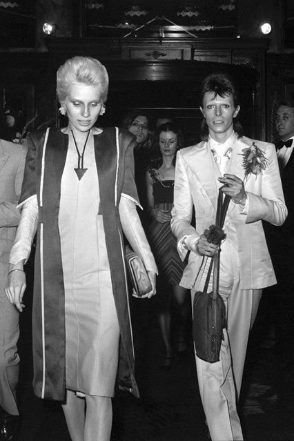 July 4 1973 With his then-wife, model, actress and musician Angie Bowie, at his retirement party, held at London's Café Royal. Although many thought he was retiring from the stage, Bowie threw the soiree to say goodbye to Ziggy Stardust – his performing persona. The event was attended by music legends including Mick Jagger, Lou Reed and Paul McCartney.