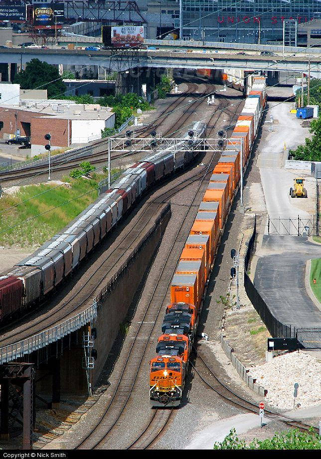 BNSF #7400 (GE ES44DC) leads the Q-CHISBD6 through Kansas City, MO on July 21, 2013. Photo by Nick Smith.