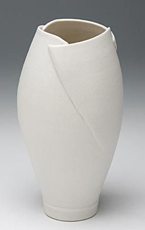 cut and fold vase - I love this. Throw a wide mouth vase and cut down the sides!