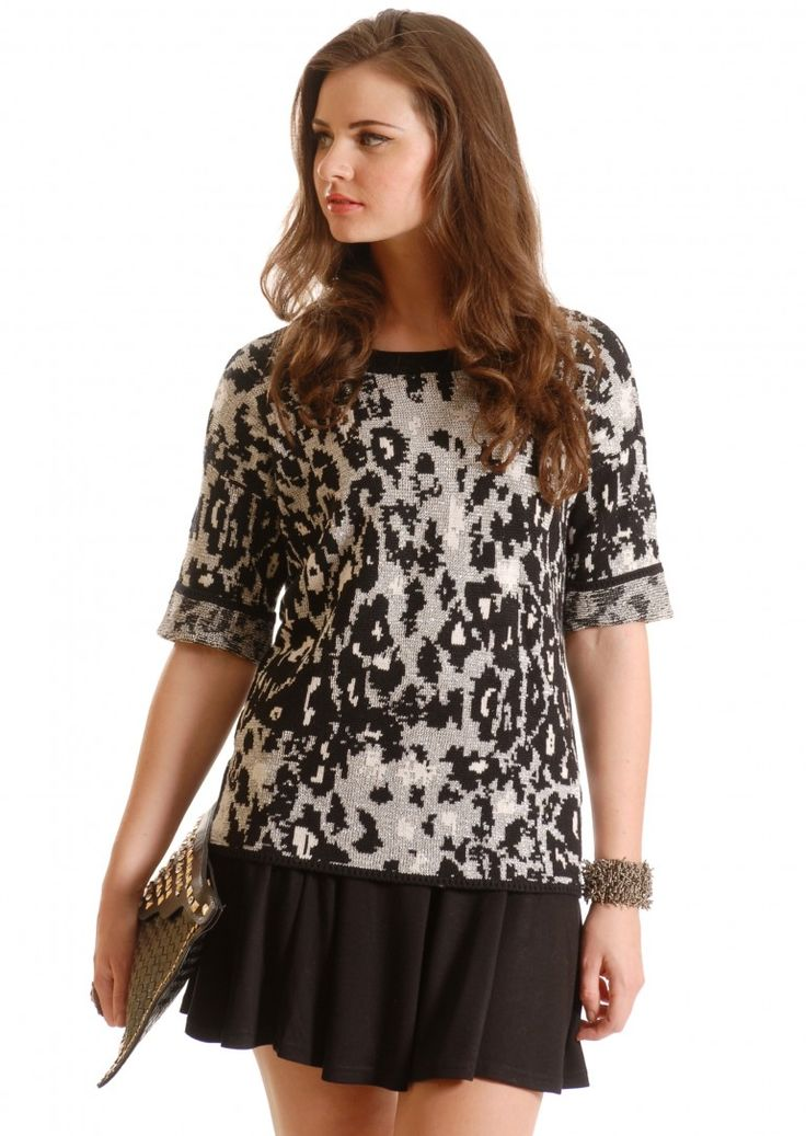 Baby it's cold outside, but you'll be lovely and warm with this gorgeous silver and black jumper with an abstract animal print and half sleeves  with a dipped hemline.  Normal price £49 - OFFER PRICE £34.50