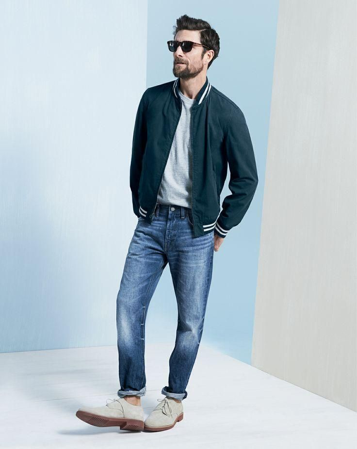 Shop this look on Lookastic:  https://lookastic.com/men/looks/bomber-jacket-crew-neck-t-shirt-jeans-derby-shoes-sunglasses/7465  — Black Sunglasses  — Grey Crew-neck T-shirt  — Teal Bomber Jacket  — Blue Jeans  — Grey Suede Derby Shoes