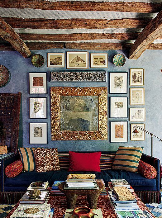 A colorful, curated mix of textiles, art, and accents enliven a seating area full of far-flung flair.