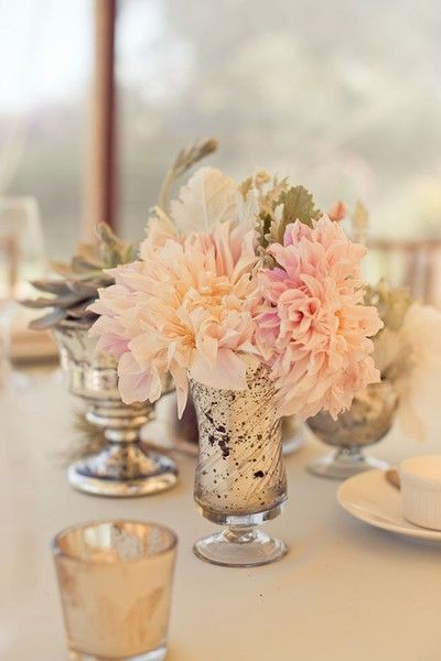 the use of mercury glass and fresh flowers for wedding decor