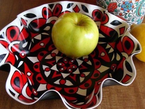 Vaan een oude lp een fruitschaal maken. Lp warm maken met een fohn en in de vorm duigen die je wilt. Heb het uit geprobeerd gaat echt heel makkelijk.