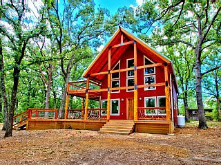 Amazing cabin overlooking a 3 acre pond on 130 acres! Beautiful new home with soaring tongue & groove pine ceilings, hand scraped pine floors and luxurious bath with large walk in shower with rain head! Windows everywhere ...