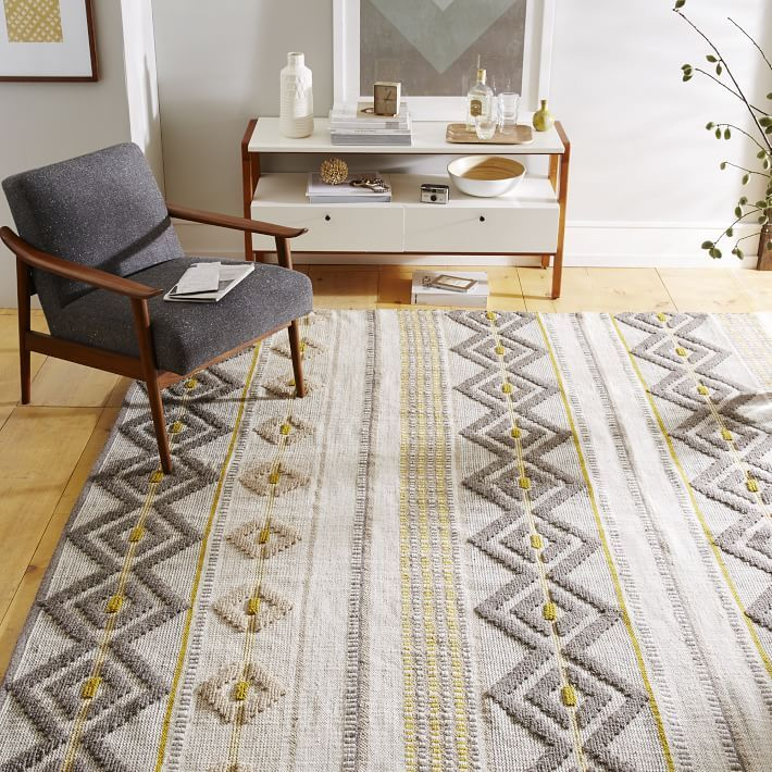 Flat woven with looped and raised patterns, our Intarsia Wool Rug has the look of a heritage piece. It was inspired by cozy Nordic winters and Fair Isle sweater patterns.