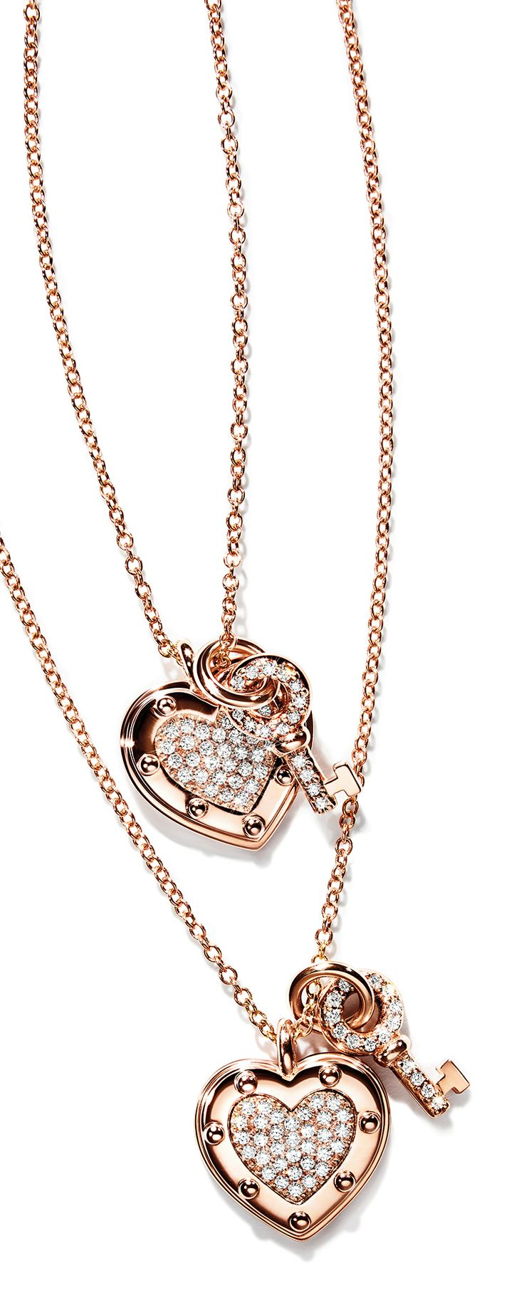 Return to Tiffany® Love heart tag key pendants in 18k rose gold with diamonds.