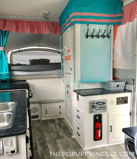 Josh and Katie took a tired Coleman camper and gave it new life with vibrant colored fabrics and neutral paints. It's the perfect family retreat.