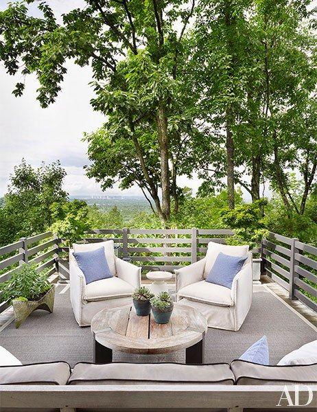 An upper terrace boasts breathtaking views | archdigest.com