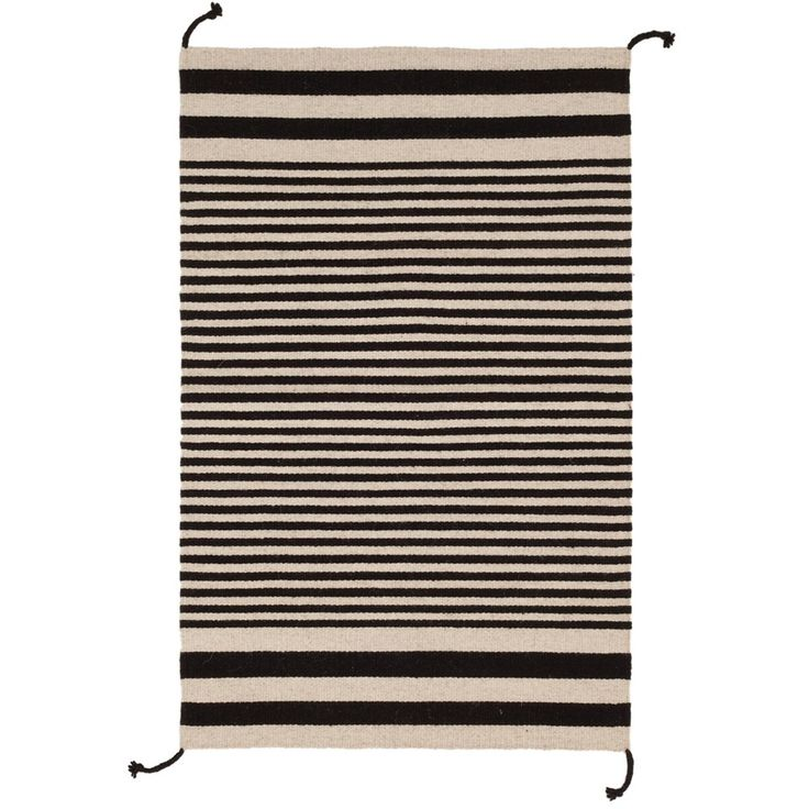 Zapotec Stripe Rug is a flatweave made from 100% Wool and handwoven in Oaxaca, Mexico. #handmade #stripes #blackandwhite