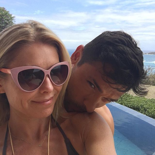 Pin for Later: Proof That Kelly Ripa and Mark Consuelos Have a Very Rare Kind of Love  Mark gave his wife a sweet peck on the shoulder during their vacation in March 2016.