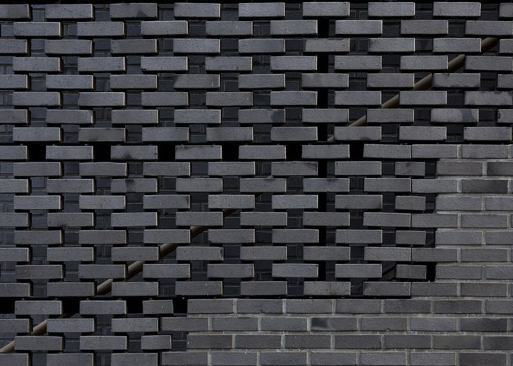 Detail shot of the perforated brick wall that fronts a Seoul office block.