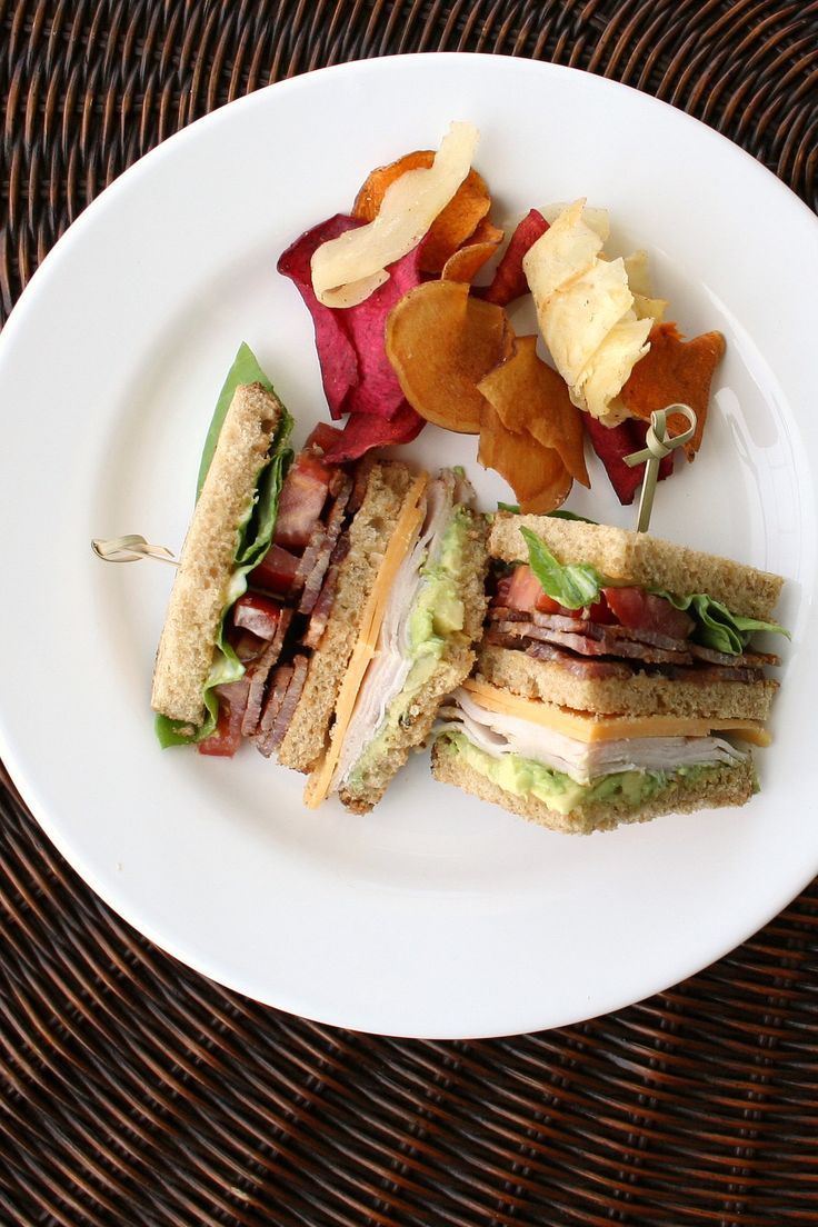 This recipe is the best turkey club sandwich recipe out there. With a few nontraditional ingredients like avocado, cheese, and mustard, it's a flavorful spin on a classic lunch favorite.