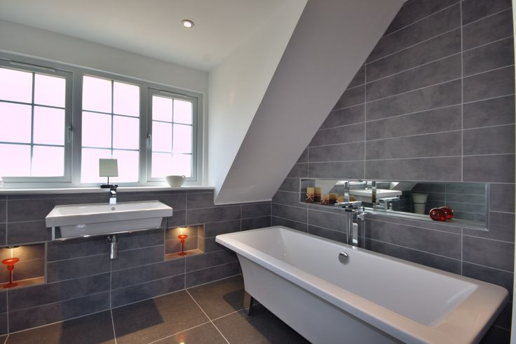 Image from http://www.homcy.com/wp-content/uploads/2015/03/bathroom-rectangle-white-bathtub-on-the-floor-and-white-floating-sink-connected-by-glass-windows-remarkable-ensuite-bathroom-ideas-brings-minimalist-idea-especially-for-us.jpg.