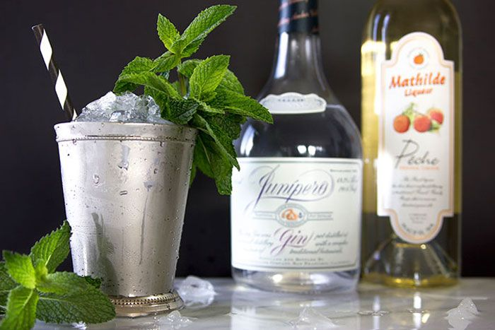 Mint Juleps with Gin and Peach from Habitant manager, Dan Yeisley  Ingredients (per cocktail) 1 1/2 ounces gin (Genever style, if possible) 1/2 ounce peach liqueur 12 good-sized mint leaves Club soda Ice, crushed Mint sprigs to garnish