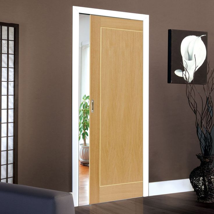 Single Pocket Roma Diana Oak sliding door system in three size widths.  #oakpocketdoor #interanlpocketdoor #modernpocketdoor
