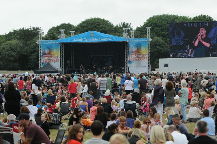 Crowds at the South Tyneside Summer Festival FREE Sunday Concert enjoying The South performing on stage.
