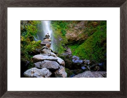 Stone Cairn with distant Waterfall Print by LazingBee at Photos.com