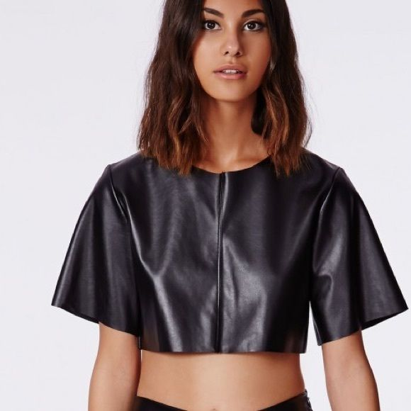 """Missguided Faux Leather Crop Top Get a sexy, captivating look with this faux leather black crop top from the Nicole Scherzinger x Missguided collection. This top is NEW WITH TAGS and features panel detailing and a concealed zipper in the back. Pair it with your favorite ripped denim or a fitted pencil skirt for a more daring look!  Approximate Length: 37cm/14""""  50% polyester 50% pu  *Model in image is wearing a size 4 and her height is 5'11"""" Missguided Tops Crop Tops"""
