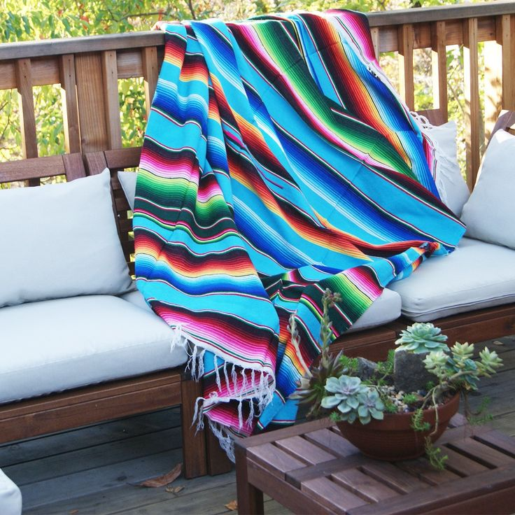 "Bright colored Mexican blanket This vibrant blanket is a must for every household. Throw it over a bed or a couch. It adds a hint of bohemia to every room. 100% Acrylic 81"" x 62"" Handwoven in Mexico                                                                                                                                                      More"