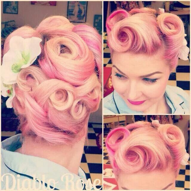 Victory rolls and pin curl updo.
