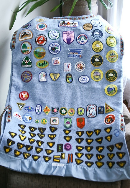 A flickr friend's photo of her Brownie sash inspired me to take pictures of my camp blanket. My uniforms were always donated to other Girl Guides, so at the end of each Guiding level my mom would sew all my badges onto a camp blanket. She got the ide This is cool!