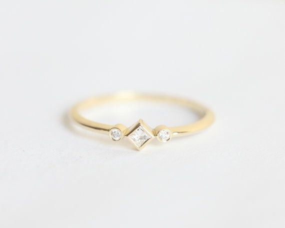 Unique, dainty and sparkly diamond ring. Tiny but still prominent. Item info…