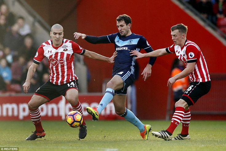 Middlesbrough's Cristhian Stuani (centre) gets between Southampton midfielders Oriol Romeu and James Ward-Prowse