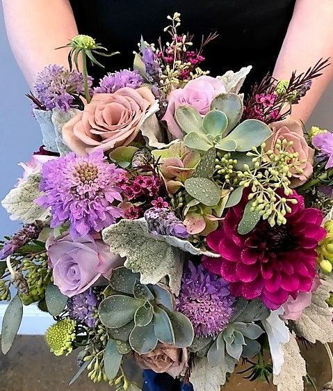 For a Fall Wedding -- LOOVVEE the play of colors and all the textures of this fall bridal bouquet... scrumptious!  Magenta Dahlia, Green Antique Hydrangea, purple Waxflower, Succulents, Cool Water Roses, Amnesia Roses, Scabiosa flowers and buds, Star of Bethlehem, Seeded Eucalyptus, Dusty Miller, Fresh Lavander Buds ... and so much more! Designed by Jenny Thomasson AIFD of Stems Florist  #fallwedding #bridalbouquet #stemsstl #stlouiswedding #weddingstlouis www.stems4weddings.com