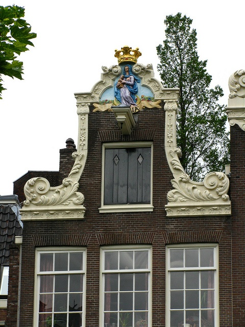 Gable of a house with a painted sculpture of teh Virgin Mary, Begijnhof, Amsterdam   Flickr - Photo Sharing!