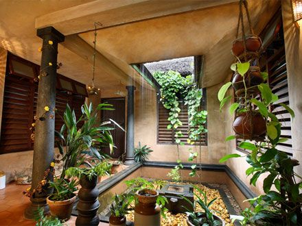 Innovative touch added to the nadumuttam traditional for Garden home interiors
