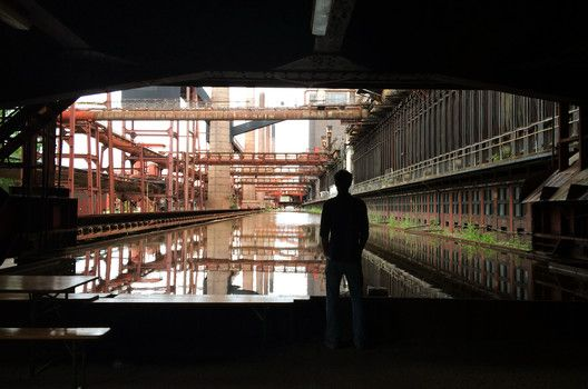 A Photographic Journey Through Zollverein: Post-Industrial Landscape Turned Machine-Age Playground,The Reflective Water Tank at the Coking Factory. Image © Gili Merin