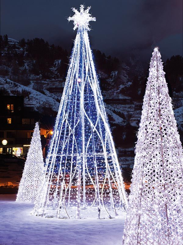A trio of sparkling trees enchants and welcomes guests.
