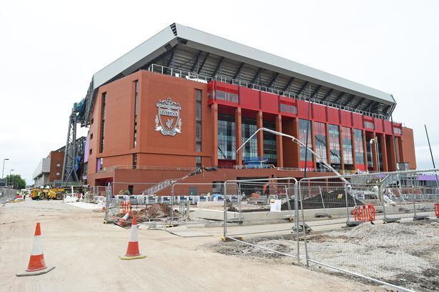 Liverpool FC new Main Stand construction and club crest at Anfield.