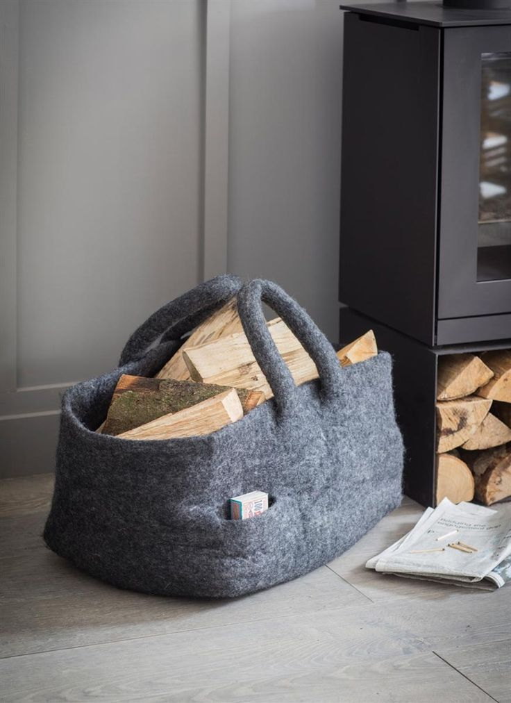 This beautifully handmade Southwold Log Basket can house an abundance of logs and comes with a handy match box pocket