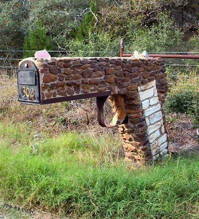 Red neck mailbox!!! I would be scared as the mailman!!
