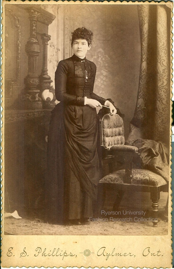 Woman standing. Photographed by E.S. Phillips of Aylmer, Ontario. FRC 2002.04.283