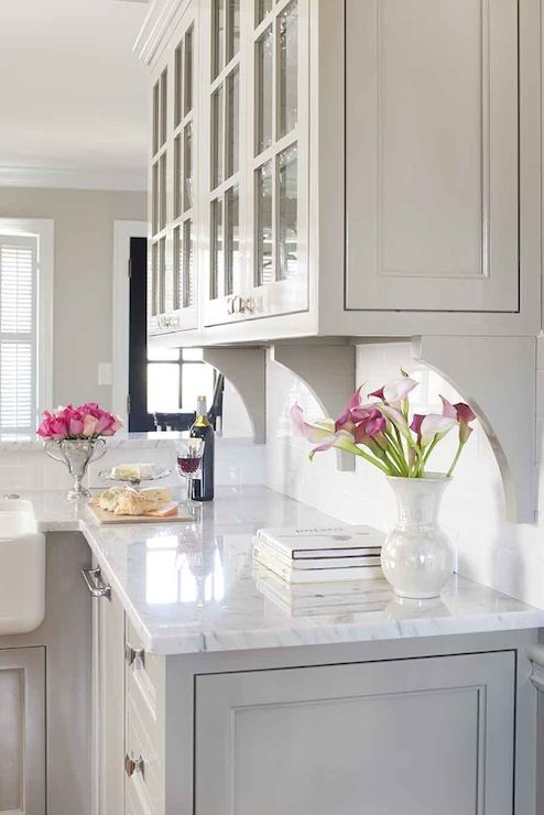 Inset White Cabinets Corbels Brackets Under Upper Glass Cabinets On Backsplash