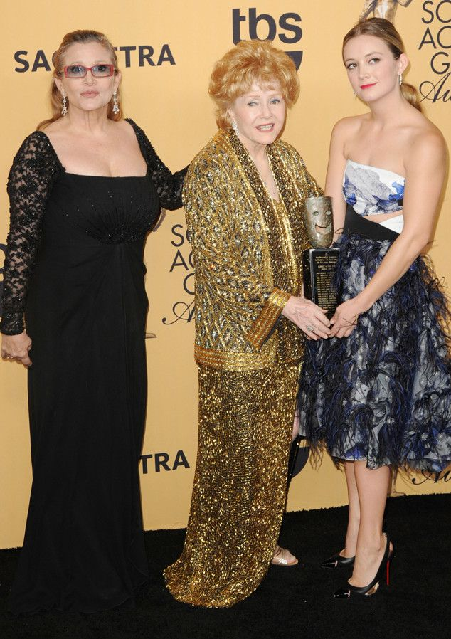 Ladies Night from Debbie Reynolds & Carrie Fisher's Mother-Daughter Moments  Debbie, Carrie and her daughter Billie Lourd appear in the press room at the 2015 Screen Actors Guild Awards.