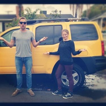 Kristen Bell and Ryan Hansen posing in front of Logan's infamous yellow X-terra : )